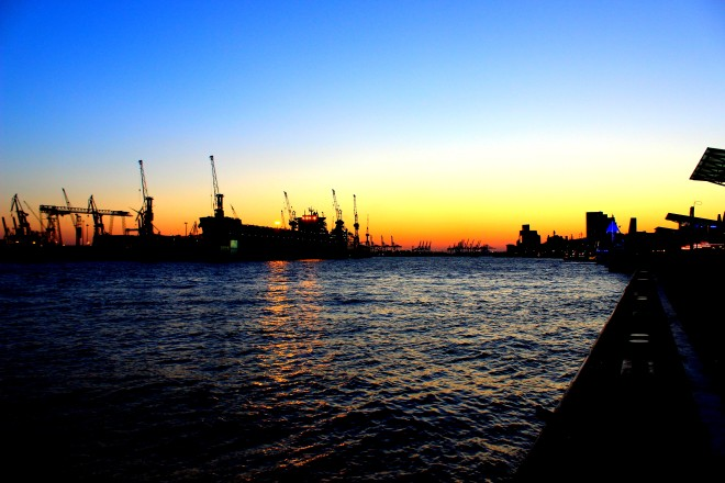 Beautiful colours of the sun setting behind the Port of Hamburg